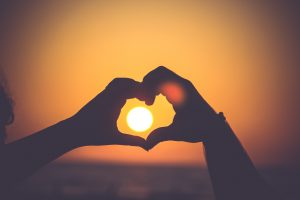 Hands making a heart over the sun, Photo by Mayur Gala on Unsplash